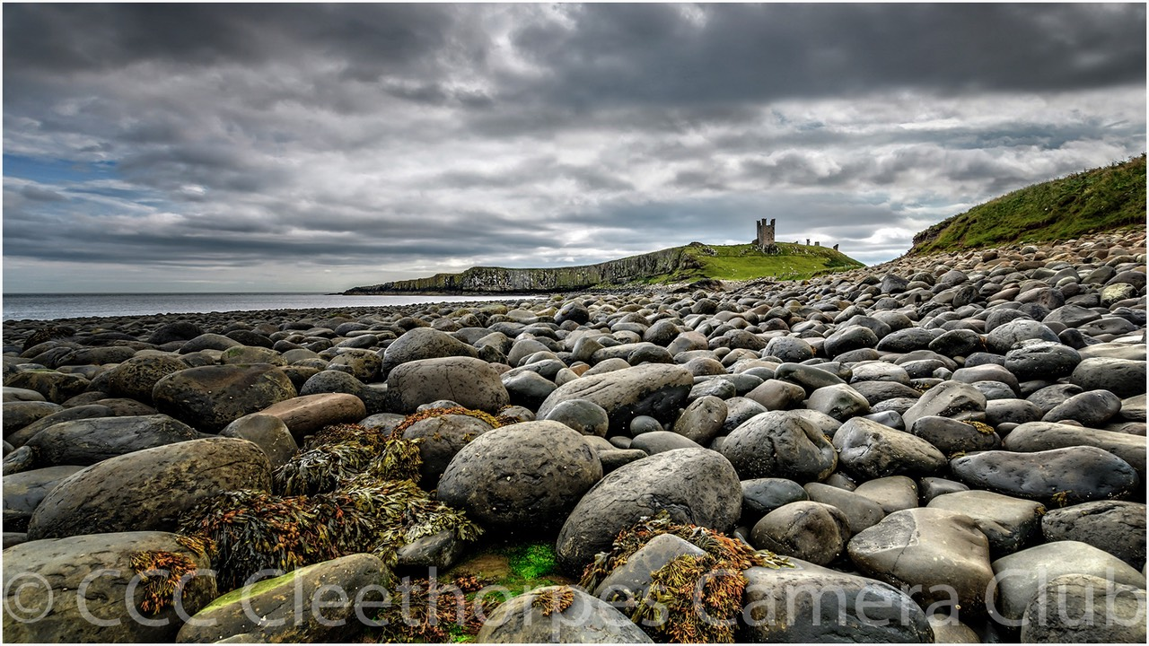 Dunstanburgh Castle from Boulder Beach